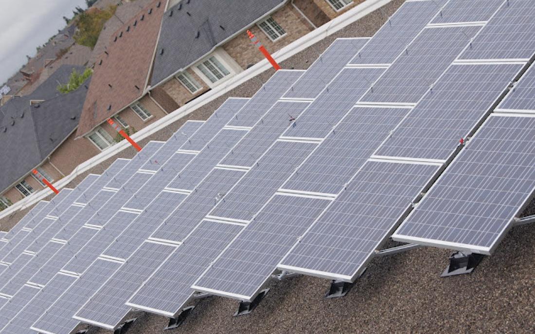 Roof top of treeline public school solar panels